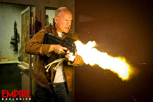 First Image Arrives From Looper Bruce Willis Is All Guns Blazing
